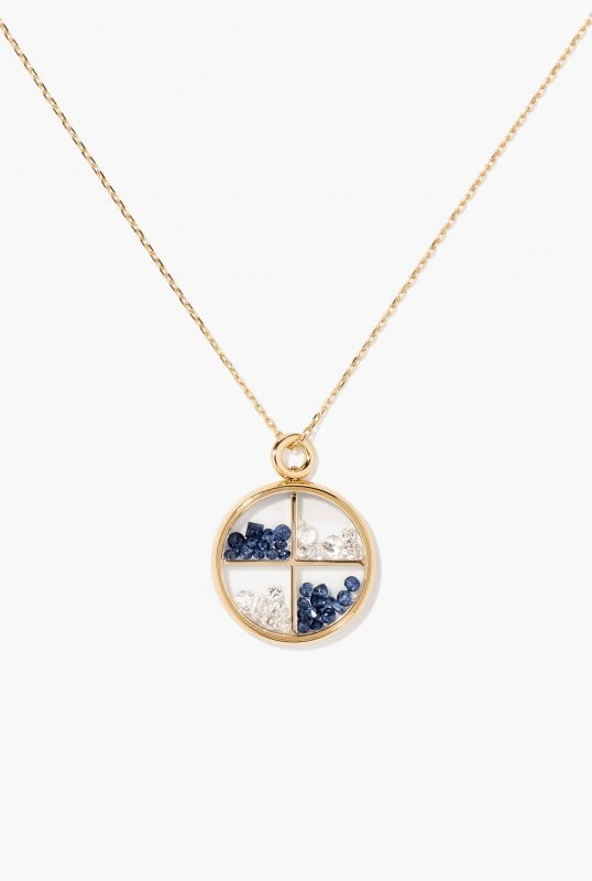Diamonds and blue sapphires compartmentalized Chivor pendant