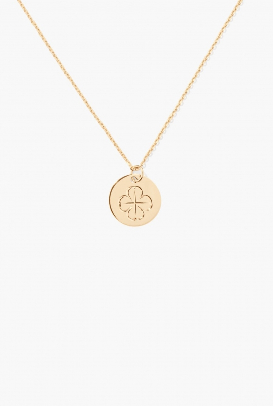 Gold medal with clover engraving